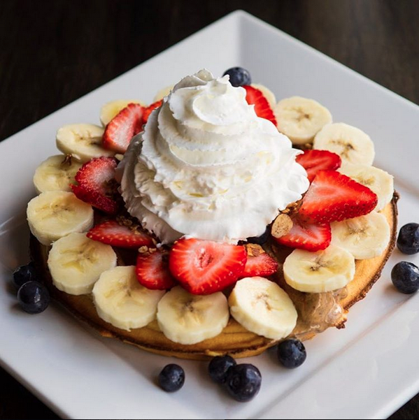 Naughty Waffle, fresh fruit, almond butter and granola