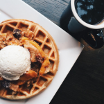 Peach Don't Kill My Vibe Waffle, peach cobbler, housemade honey whipped cream